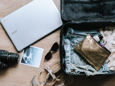 Must-have travel items packed in a suitcase