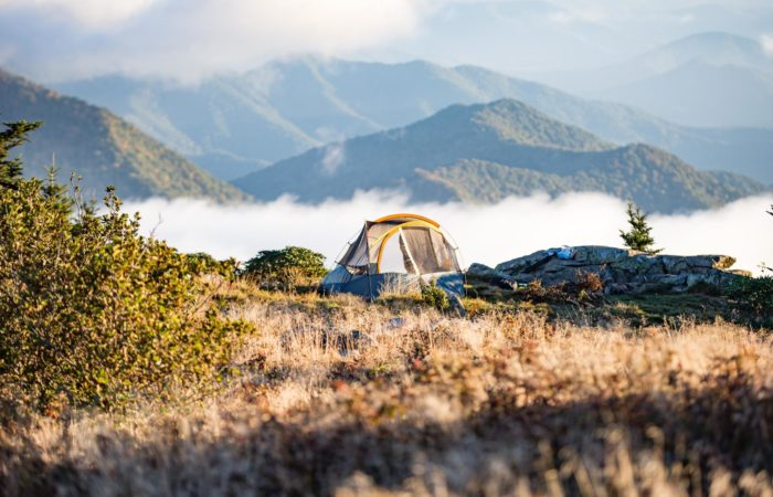Camping tent overlooking fog on a mountain
